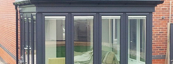 Orangery with grey framed windows and French doors